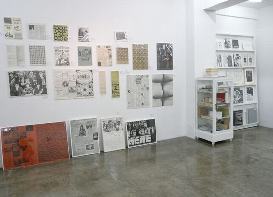 Works by Fluxus artists displayed on the gallery wall