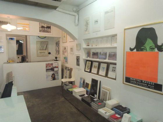 Edition prints and books are sold next to the gallery's exhibition space