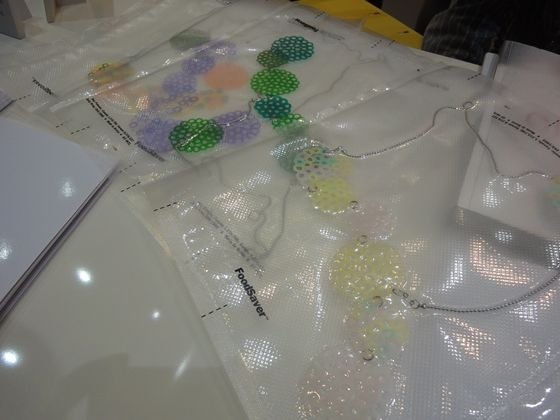 This is from the jewelry booth. Each little circles are cut straws. They are melted and connected like a flower. Very cute!