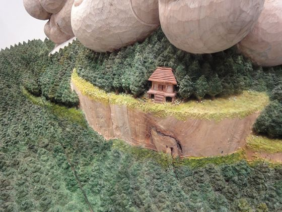 Seeing detail of the sculpture, there is a little house set secretly in the forest.