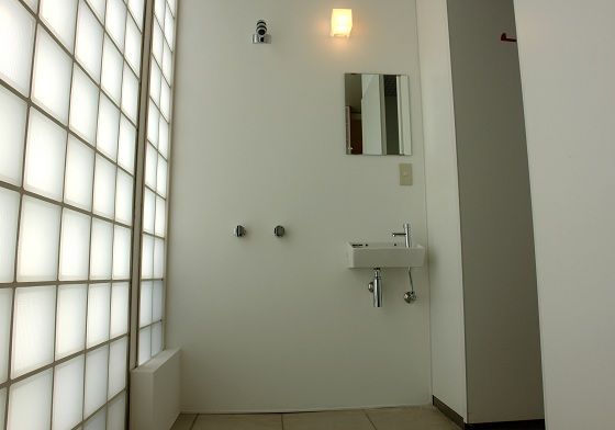 Bathroom of Nakanoshima Hotel. A toilet compartment is one of the public restrooms.