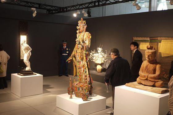 "Sculptures welcome visitors. In the foreground, Female Shinto Deity (Heian period), followed by ""BUTSU"" of Yuji Honbori and ""HITOGATA"" of Makoto Sasaki"