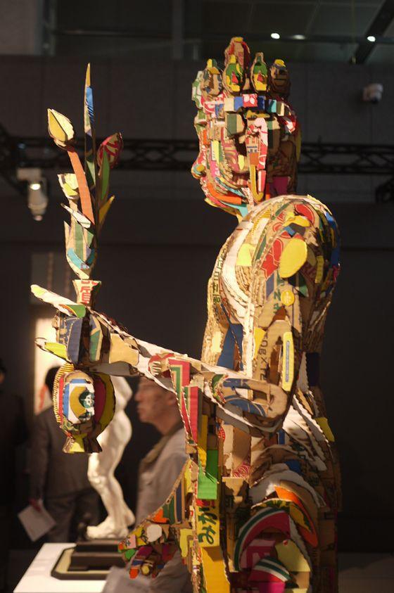"lose up of the Buddha in carboard, ""BUTSU"" by Yuji Honbori from one of Azito's partner gallery NANZUKA."