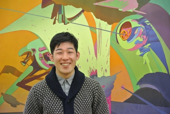Ryuichiro Ando in front of his work.