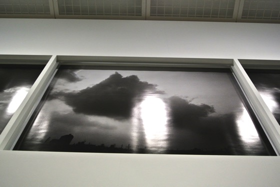 "Nobuyoshi Araki ""Eastern Sky 2014"" seen from the bottom. It is set in a window like frame."