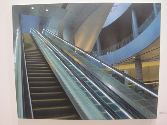 Hisaya Taira's series of seemingly mundane 'photos' are revealed to be impressively realistic paintings upon closer inspection, which speak of the artist's painstaking attention to detail. 'Escalator#24'