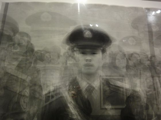 "Close up of the work ""Metaportrait of 24 soldiers guarding Tian'anmen Square"" by Ken Kitano,"