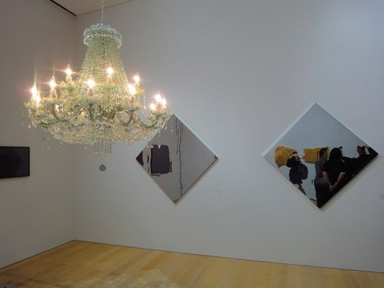 Artwork by Haruka Kojin (chandelier) and Yusuke Komuta (mirror-like work on the wall) at SCAI THE BATHHOUSE