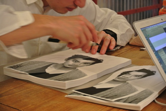 "Artist, Nerhol cutting printed paper one by one for the book ""Compilation Tokyo""."