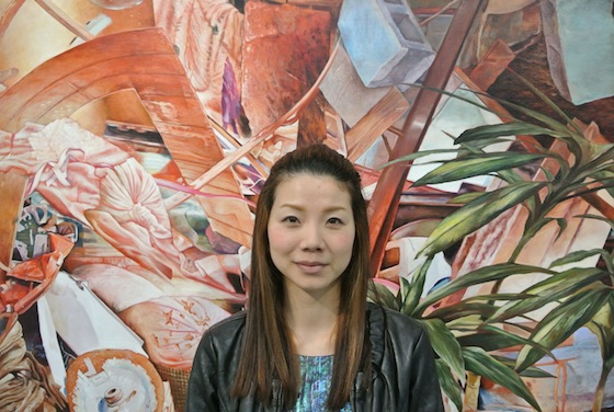 Painter, Kei Imazu in front of her work.