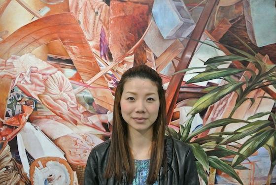 Painter, Kei Imazu in front of her work.