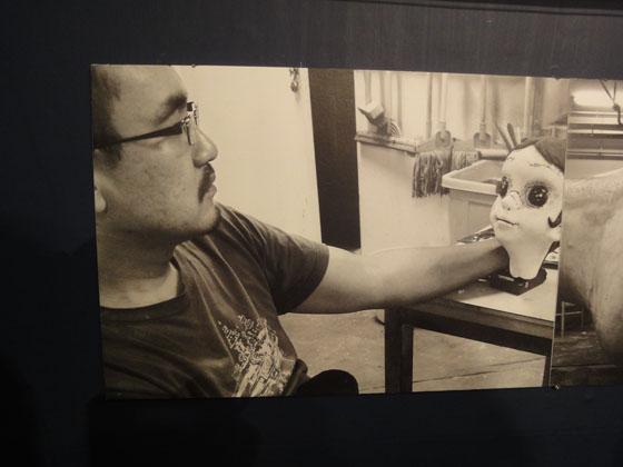 """Kenji Yanobe working over """"Sun Child"""", exhibition view of """"Kenji Yanobe: Sun Child, Taro's Children"""""""