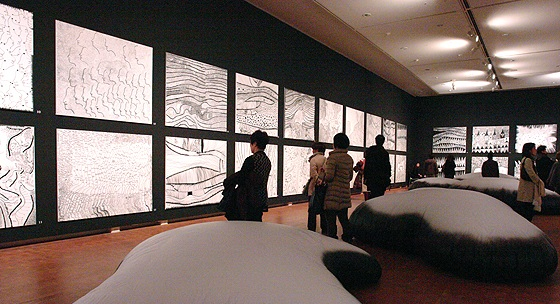 "Exhibition view of ""Love Forever"" series (drawings on the wall) and ""Clouds"" (large sculptures on the floor) in Yayoi Kusama ""Eternity of Eternal Eternity"""