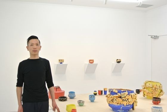 Artist Takuro Kuwata standing in the gallery among pieces of his art. 8/ ART GALLERY/ Tomio Koyama Gallery.