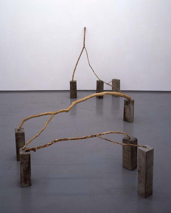 "Kishio Suga ""separating space"" 1975, branch and cement block, H184 x W240 x D460 cm Photo by Yoshitaka Uchida"
