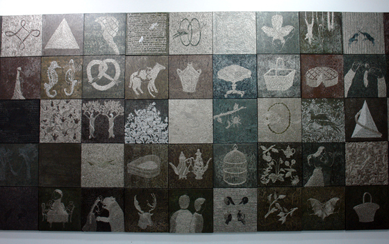 Completed pieces on the wall of the studio.