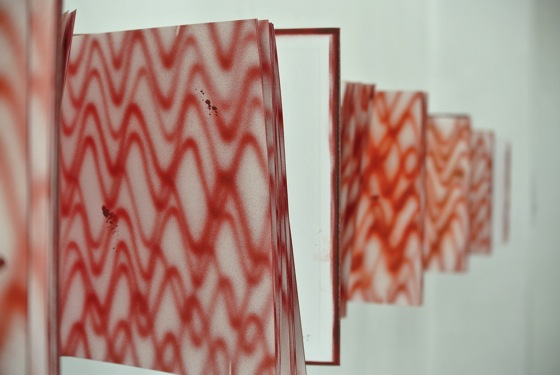 Sasaki drew heartbeats in books at LA ART BOOK FAIR, The Museum of Contemporary Art, Los Angeles.