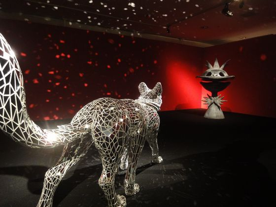 Six footed wolf sculpture by Tomoko Konoike (left), facing Kappa sculpture by Taro Okamoto (right).