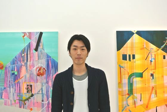 Watanabe in front of his work
