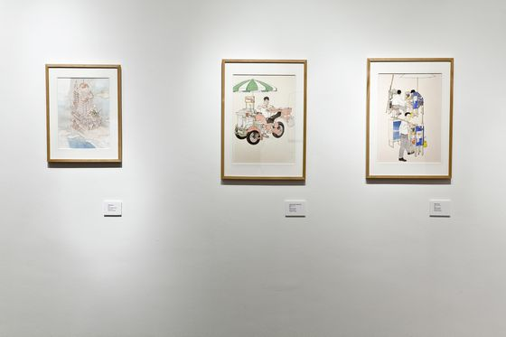 """Singa-planet"", seen on the left, was used as the main image for posters and fliers to the exhibition. Photo by Ernest Goh"