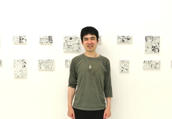 Yuichi Yokoyama in front of his works